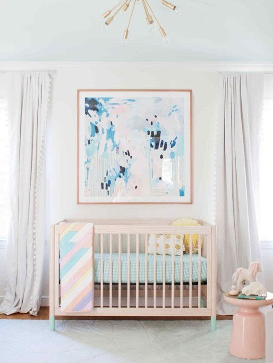abstract painting over baby girl crib