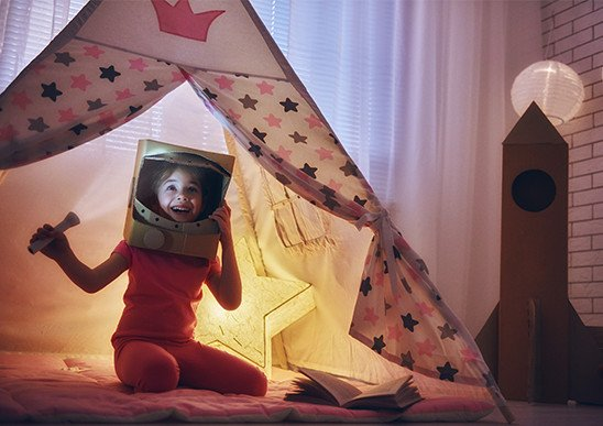 Star light in teepee with girl playing