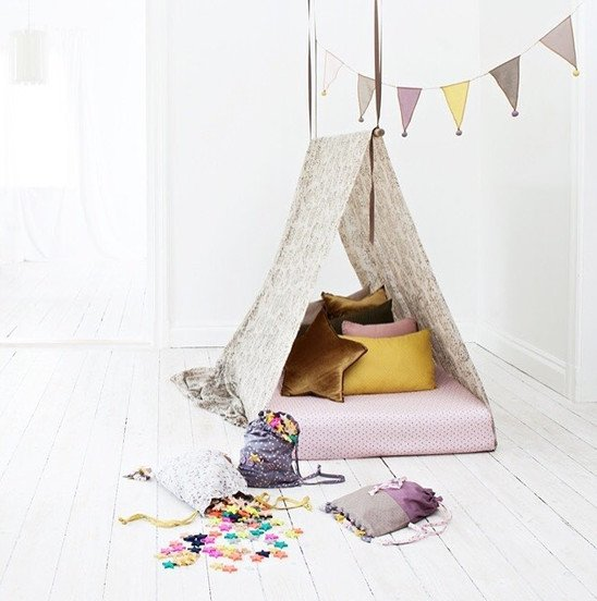 Play tent with pillow and garland