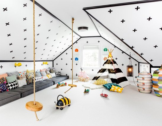 Playroom with swings and large sofa